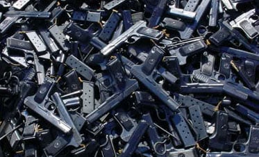 A pile of guns and magazines.