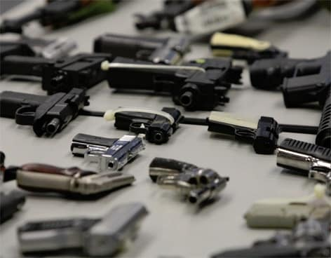 confiscated handguns and pistols displayed out