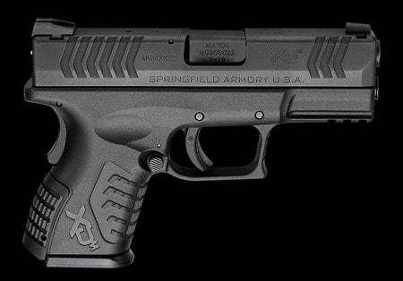 xdm handgun on black background