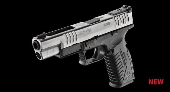 steel xdm pistol on black background