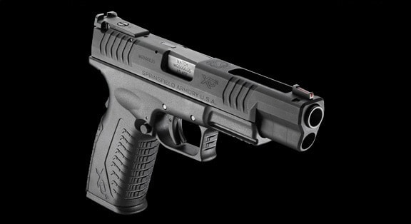 springfield armory xdm compact handgun on black background