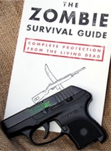 """""""The Zombie Survival Guide"""" by Max Brooks accompanied with a Ruger LCP"""