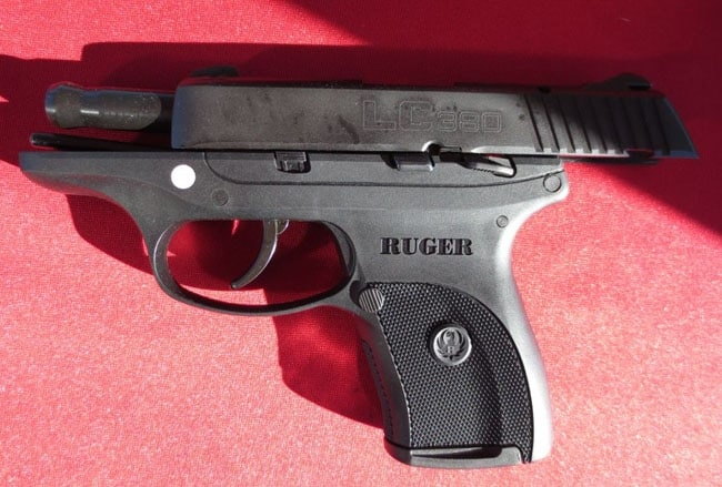 ruger lc380 sitting on red cloth