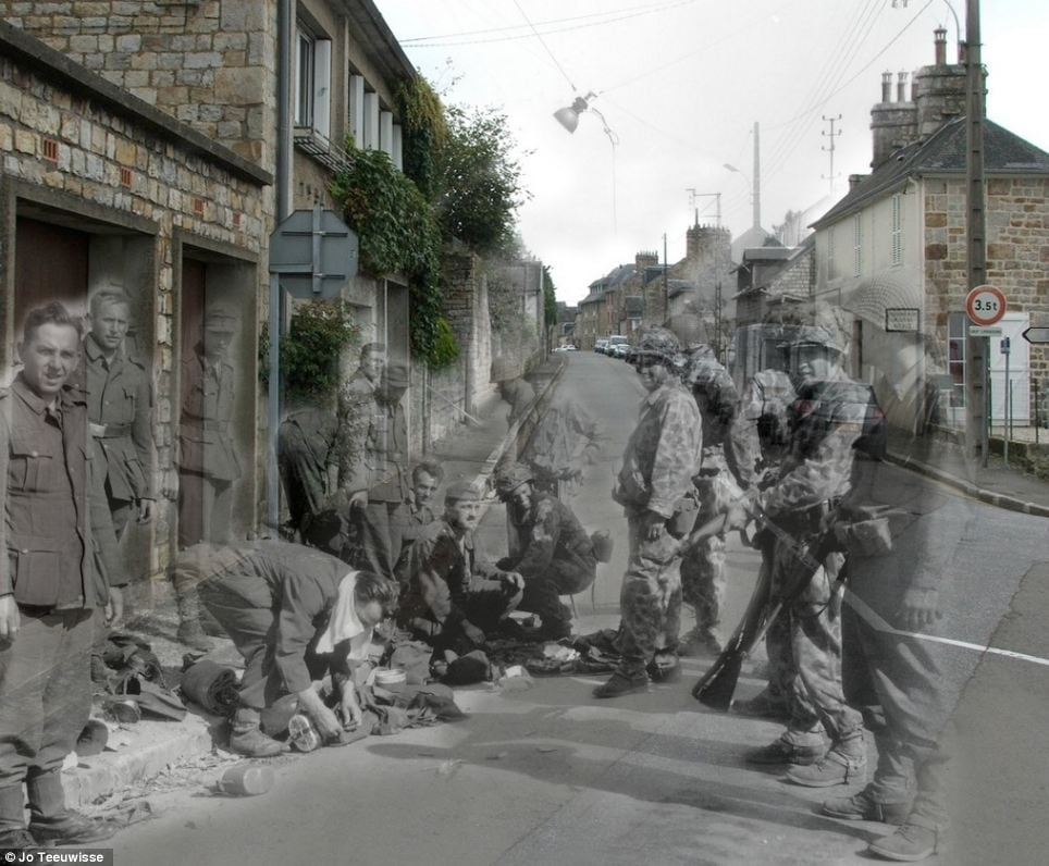 German soldiers surrendering beside the modern terraced houses of the Rue des Fossés Plissons in Domfront, Orne