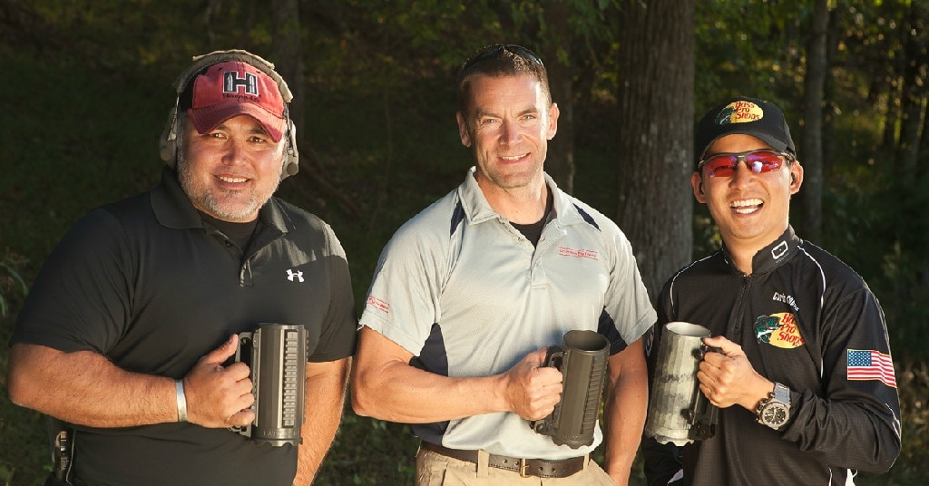 Battle Mug owner Joe Lundberg, lian Harrison (Top Shot Season 1 winner), and Chris Cheng (Top Shot Season 4 winner) sporting their Battle Mugs at a recent firearms industry range day.