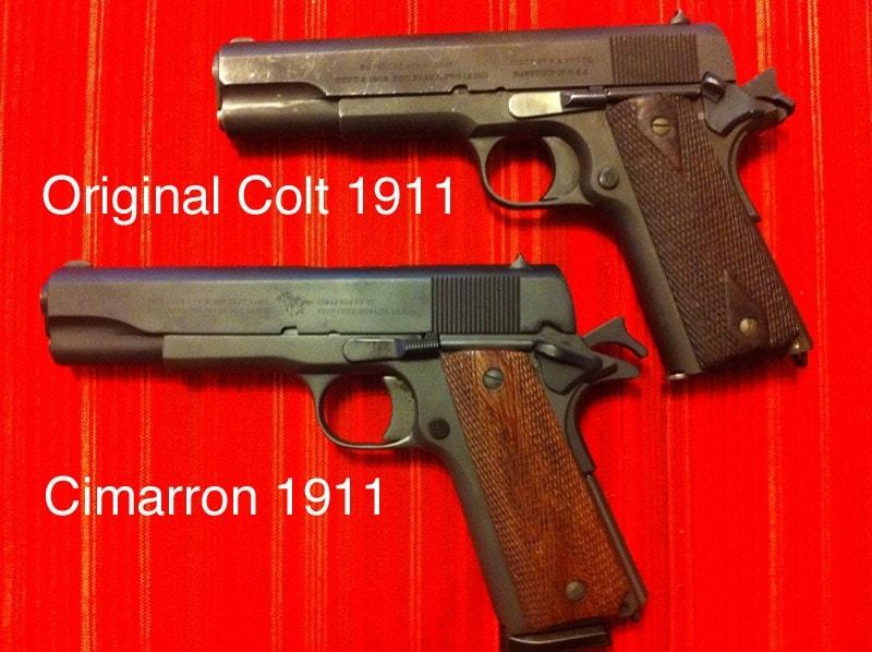 The Cimarron 1911, bottom, and an original Colt 1911.