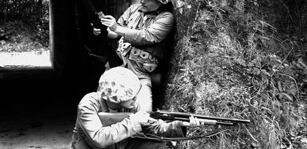WWII Marines advance with a Winchester 1897