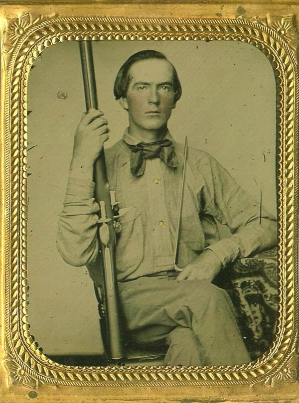 Confederate soldier with a converted flintlock rifle of unknown make