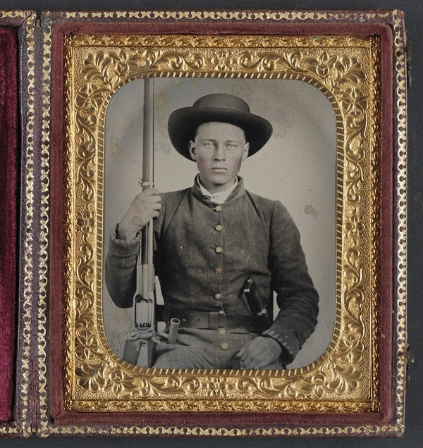Unidentified Confederate soldier with Colt revolving rifle, Model 1855
