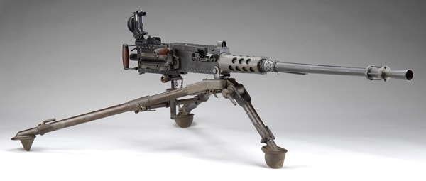 M2 featuring a tripod and flash muzzle
