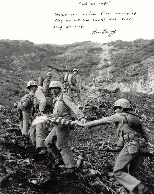 Low Lowery's Photo of Marines carry up the first flag.