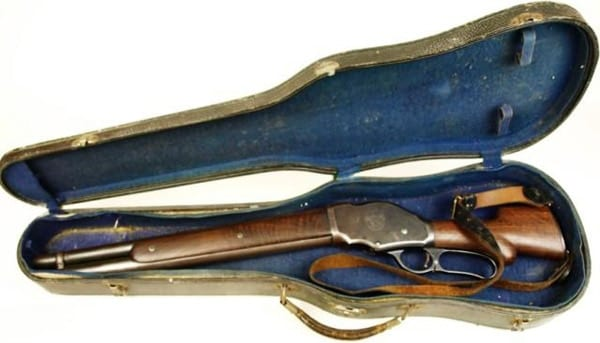 Winchester 1887 lever shotgun (1901 make) shortened and fitted to a violin case
