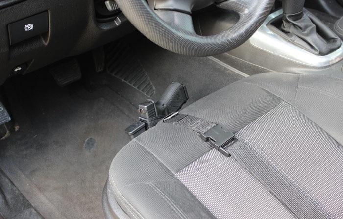 kingston strap gun holster on car seat