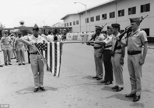 In this March 29, 1973 file photo, the American flag is furled at a ceremony marking official deactivation of the Military Assistance Command-Vietnam (MACV) in Saigon, after more than 11 years in South Vietnam