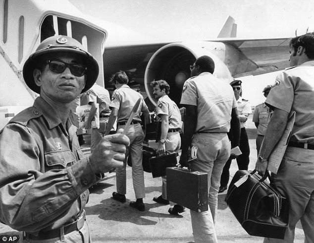 In this March 28, 1973 photo, a Viet Cong observer of the Four Party Joint Military Commission counts U.S. troops as they prepare to board jet aircraft at Saigon's Tan Son Nhut airport