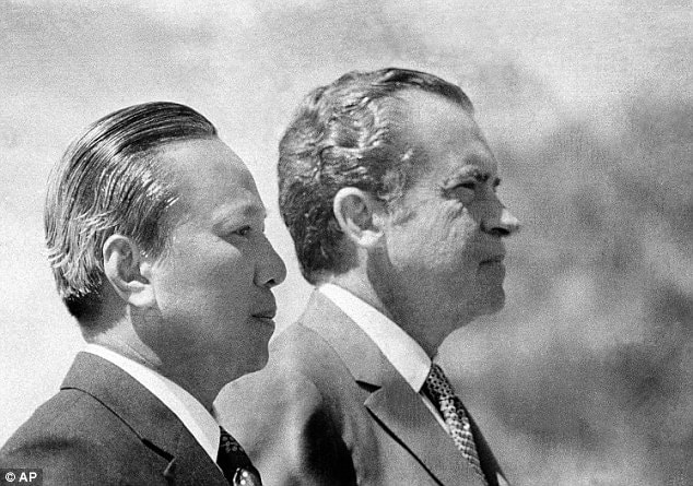 In this April 2, 1973 photo, President Richard Nixon and South Vietnamese President Nguyen Van Thieu are in profile as they listen to national anthems during arrival ceremonies for Thieu at the Western White House in San Clemente, Calif