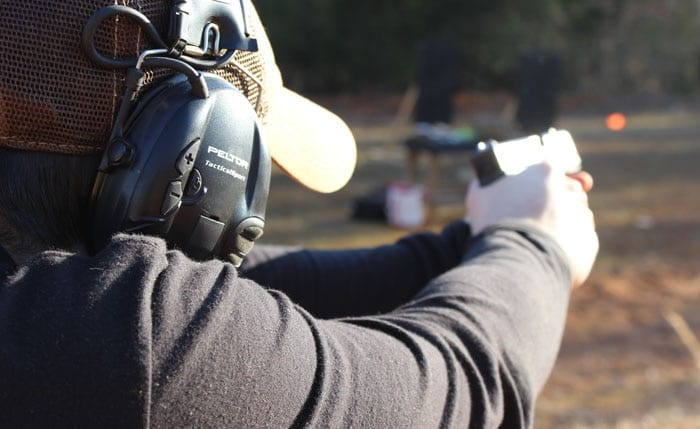 man shooting g30s
