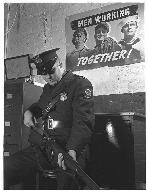 Greener style shotgun with US prison guard,