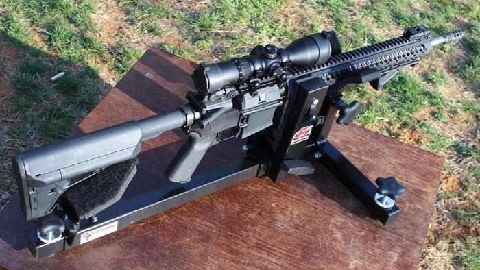 konuspro scope mounted to rifle sitting on table