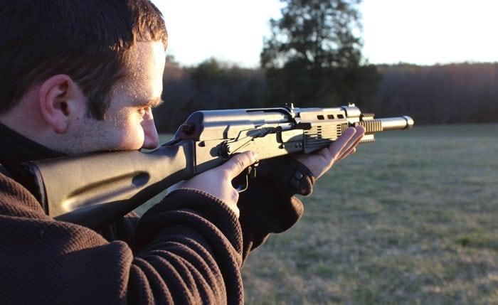 shooter with a saiga 12 outside