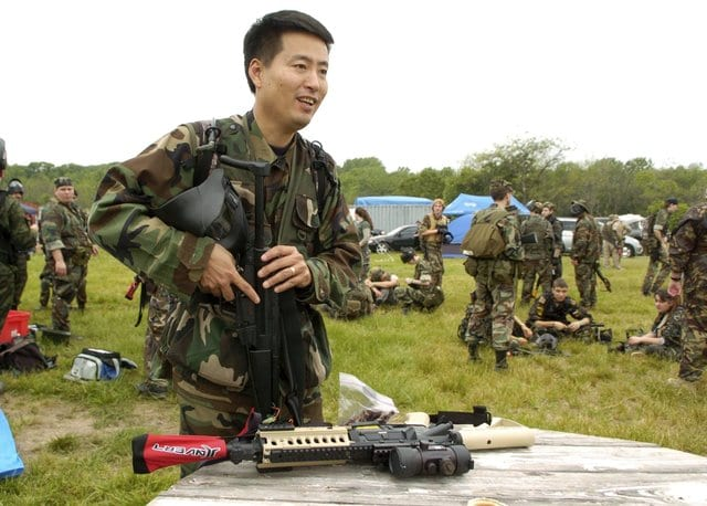 Michael Kim prepares for his first airsoft game. Many participants have military or law enforcement experience and play to keep their skills sharp. (The Washington Times)