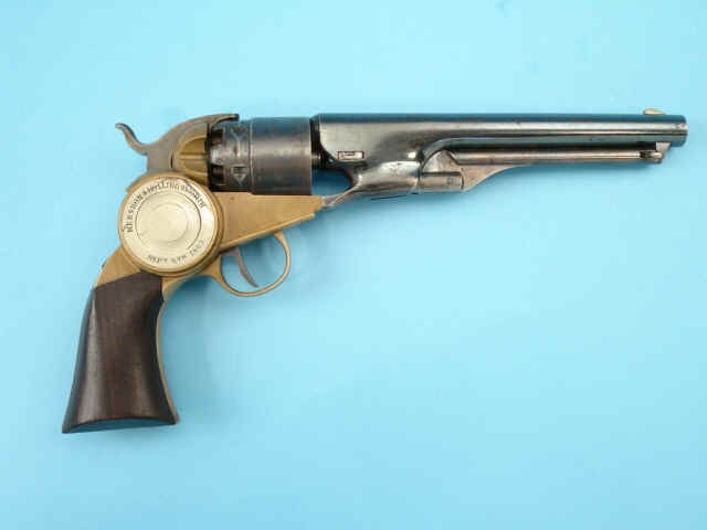 self cocking revolver on blue background display