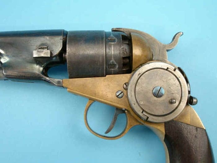 self cocking revolver on blue background display chamber view