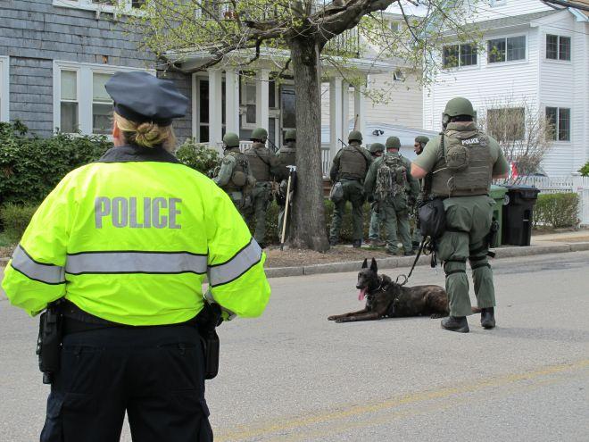 Police conduct door-to-door searches in Watertown, Mass. (Photo credit: Fox News)