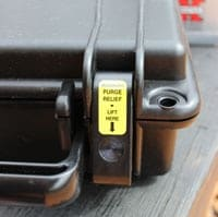 seahorse pressure release button on gun case