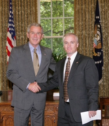 CJ Grisham receiving honors from President Bush