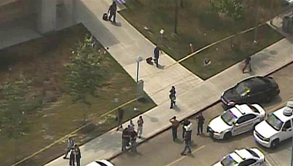 Students flee and crowd gathers at Lone Star College in Houston after a mass stabbing incident.