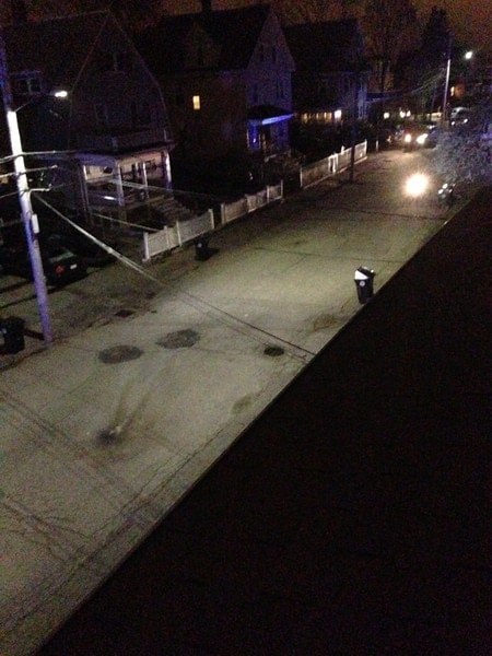 At the bottom of this image is the blast mark from the pressure cooker bomb that exploded in the middle of the street. At the top of the image, the bright light is a bomb detecting robot that was moving toward the blast mark. (Taken at 1:20:10AM)