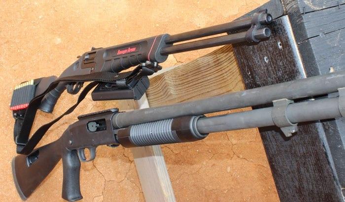 2 model 42 shotguns sitting next to table
