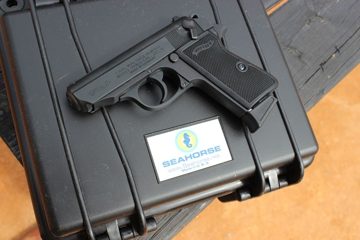 walther handgun sitting on top of seahorse case