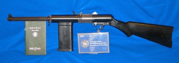 Smith and Wesson 1940 Light Rifle with user manual on blue cloth