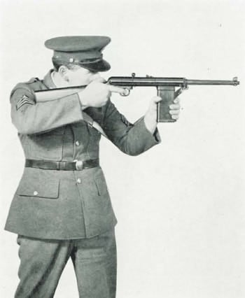 black and white photo of officer shooting rifle