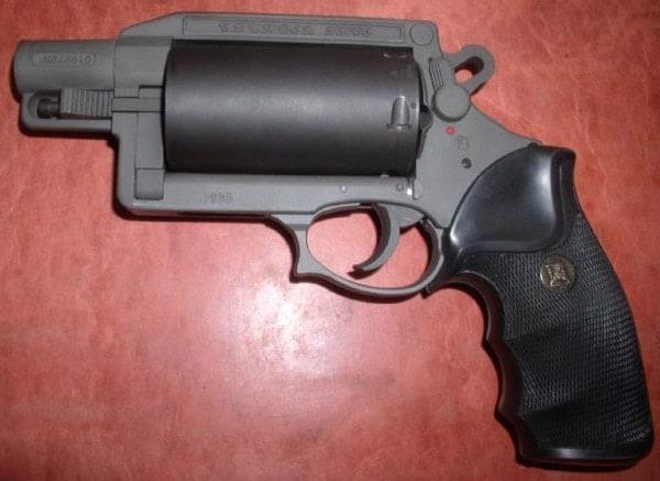 Thunder 5 revolver on red table