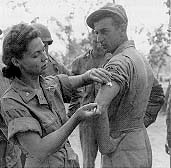 U.S. Army nurse instructs Army medics on the proper method of giving an injection, Queensland, Australia, 1942. (Photo credit: U.S. Army)