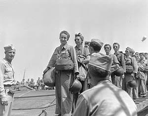 LT Mary Jane Hinckley of Millville, NJ and nurses of the 95th Evacuation Hospital being checked off the loading roster as they load on a ship that will take them to their unit on the invasion front on the southern coast of France. (Photo credit: U.S. Army)