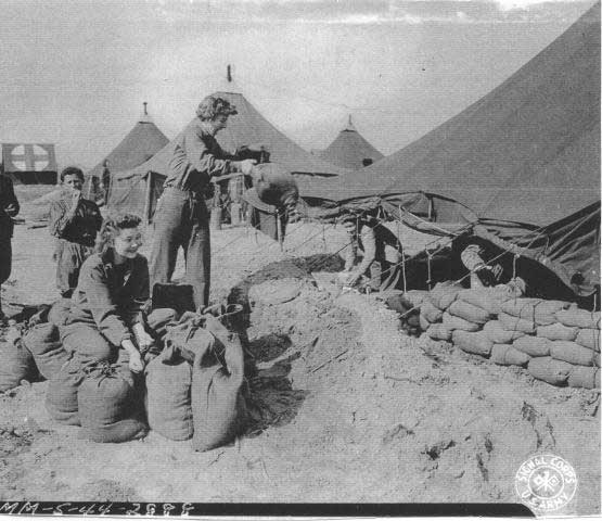 U.S. Army nurses fill and place sandbags around their living quarters in order to provide better protection against German bombs and shrapnel. (Photo credit: Evelyn Monahan and Rosemary Neidel-Greenlee)