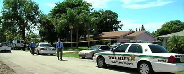 Police investigate a Tuesday afternoon attempted break-in which resulted in one of the suspects being shot. (Photo credit: The Palm Beach Post)