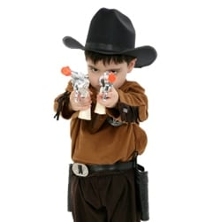 kid poses as cowboys with 2 toy cap guns