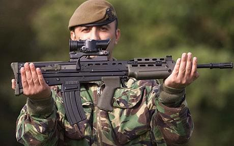 Soldier shows off the L85 compact size
