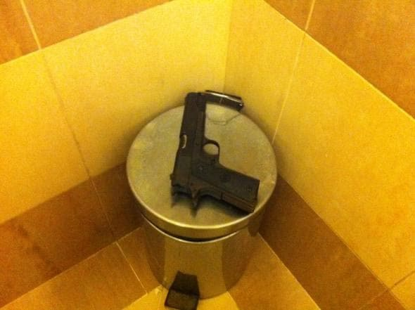 Lost and found gun on top of small metal trashcan