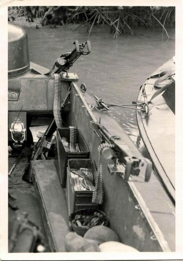 Spade drip M60s on Riverine boat in Vietnam. Check out the C-ration cans wired to the left side of the gun to aid in ammo feeding.