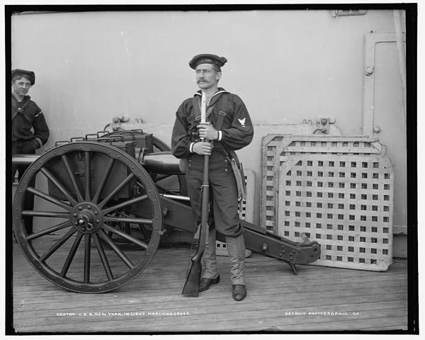 Turn of the century US navy sailor with Lee rifle in landing party gear