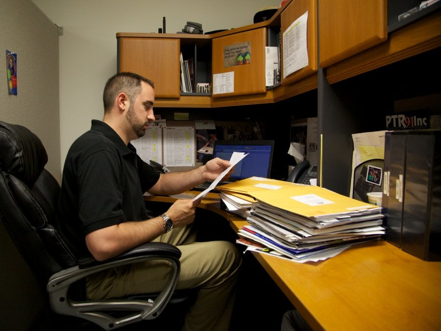 PTR Industries John McNamara wades through a stack of letters asking them to move to a specific location.