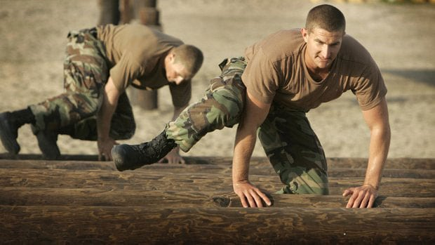 Navy SEAL candidates near the end of the obstacle course. (Photo credit: UT San Diego)