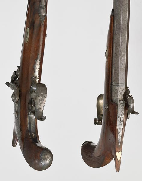 Pair of identical dueling pistols with extensive scroll work