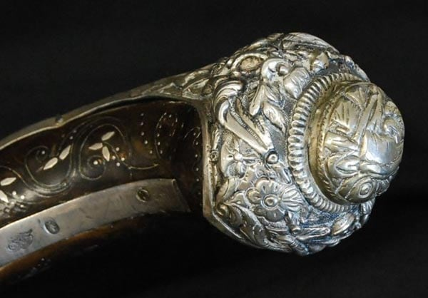 Ornate inlays on flintlock dueling pistol